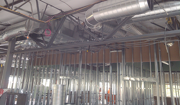 Exposed duct work on new construction.